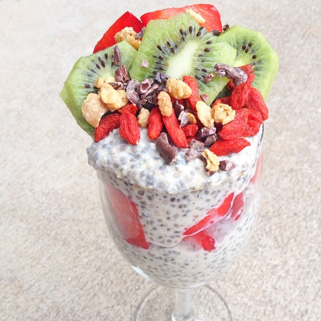 Coconut flavored layered with strawberries + kiwis + bananas + goji berries + cacao nibs + peanut butter granola
